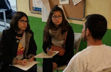 3-students-interviewing-at-the-casa-migrante-tijuana..jpg